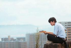 ギターに夢中のコユキ「BECK」