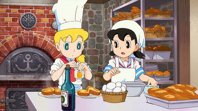 お料理をしているカッコイイドラえもん 宝島の画像です。